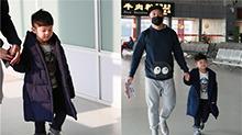 沙溢父子现身机场 安吉穿长外套霸气十足